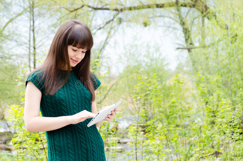 woman charming girl standing with tablet pc stock photos