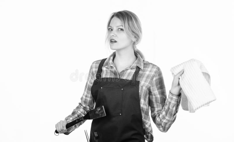 Woman checkered shirt and apron for cooking white background. Cooking meat at low temperature for long time outdoors. Picnic and barbecue. Cooking meat in park stock images