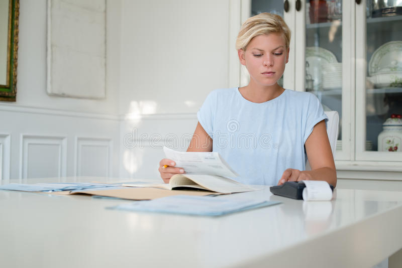 Download Woman Checking Bills And Doing Budget Stock Photo - Image: 26905836