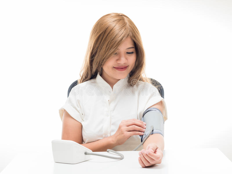 Woman checking blood pressure stock photos