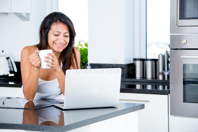Woman checking emails in the morning