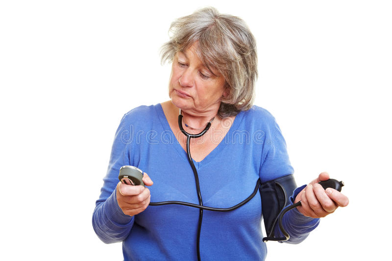 Woman Checking Her Blood Pressure Royalty Free Stock Photography