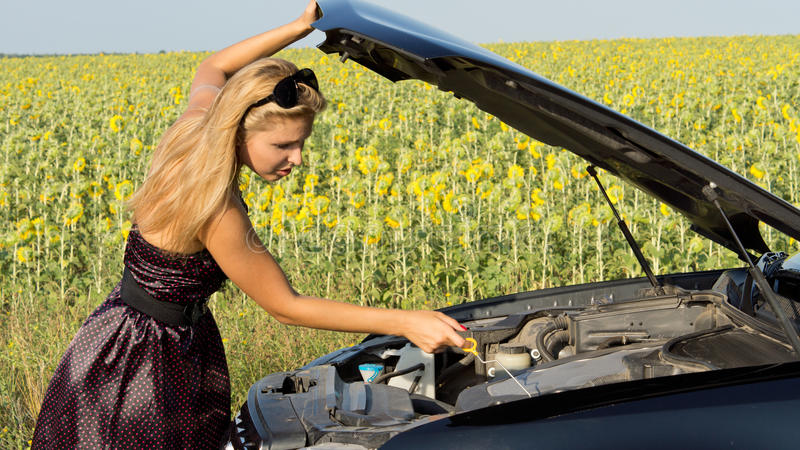 Download Woman Checking Her Engine Oil Stock Photo - Image: 25899820