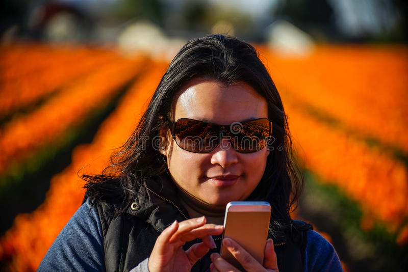Woman checking her messages on her mobile phone stock images
