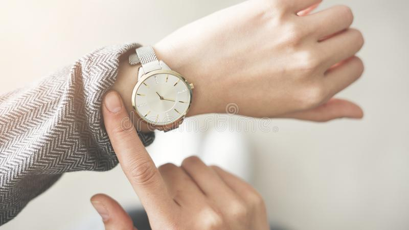 Woman checking time her watch royalty free stock image