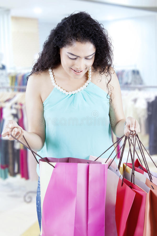 Woman checks shopping bags in the fashion center royalty free stock photo