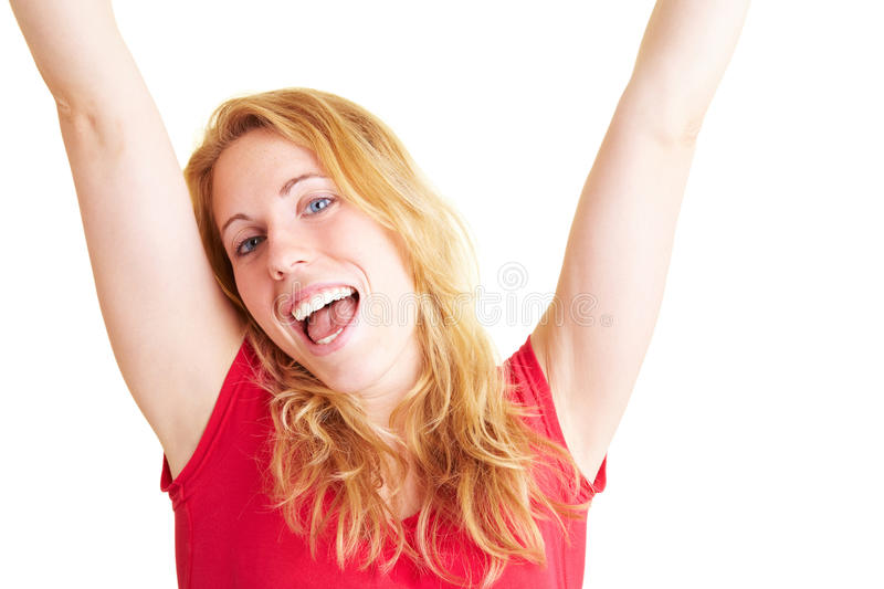 Woman cheering. Happy woman smiling and cheering with her arms stretched royalty free stock photo