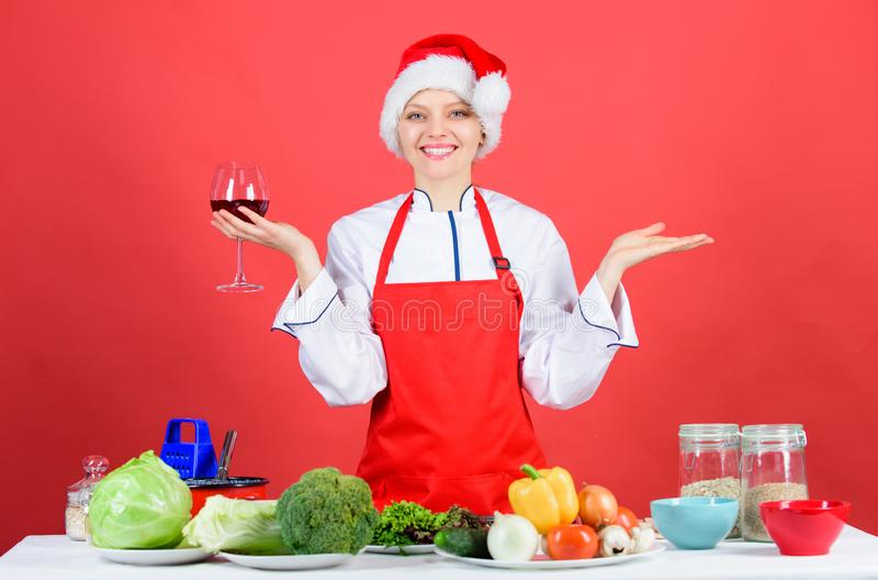 Woman chef cooking christmas dinner wear santa hat. Best christmas recipes. Enjoy easy ideas for holiday parties and. Holiday dinners. Festive menu concept stock photos