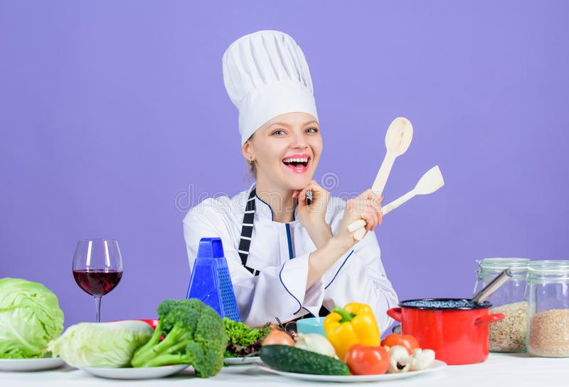 Woman chef cooking healthy food. Gourmet main dish recipes. Cooking is her hobby. Girl in hat and apron. Delicious royalty free stock photo