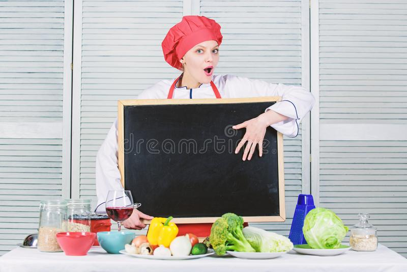 Woman chef hat apron hold blackboard copy space. Chef job position. Cooking delicious meal step by step. Cooking menu royalty free stock photo