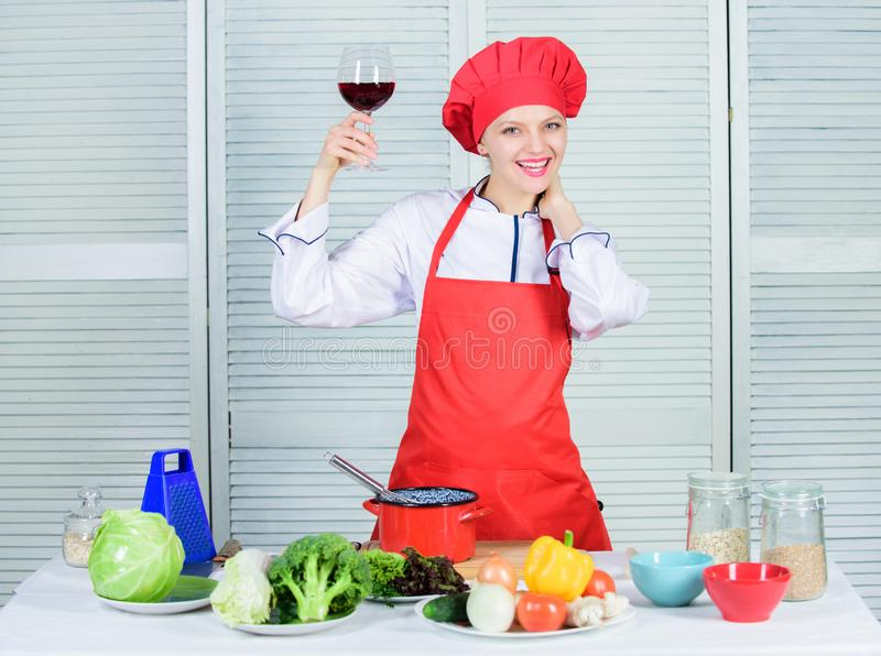 Woman chef hold glass of wine. Which wine to serve with dinner. Exquisite dinner concept. Wine degustation. How to match. Wine and food like expert. Girl wear royalty free stock photos