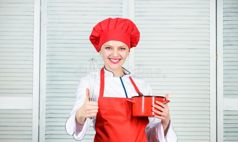Woman chef hold whisk and pot. Girl in apron whipping eggs or cream. Start slowly whisking or beating cream stock photo