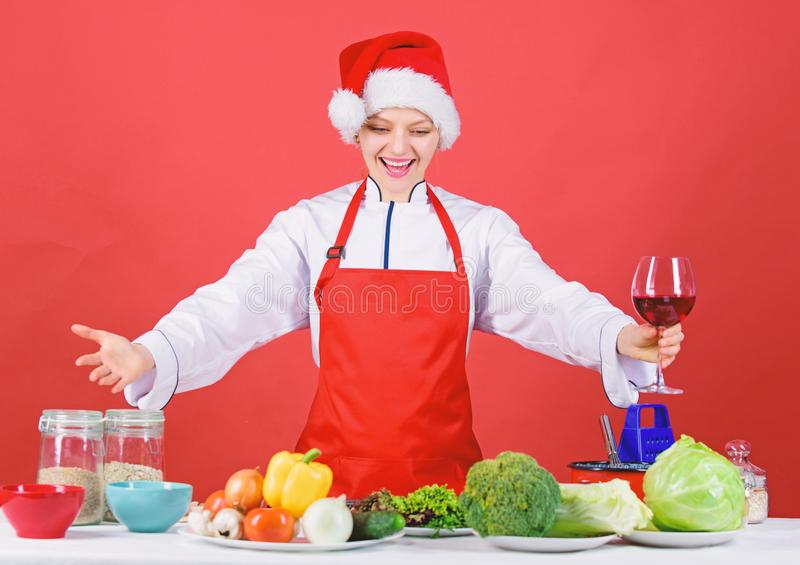 Woman chef or housewife cooking and drink wine. No stress. Best christmas recipes. Enjoy easy ideas for winter party and stock photo