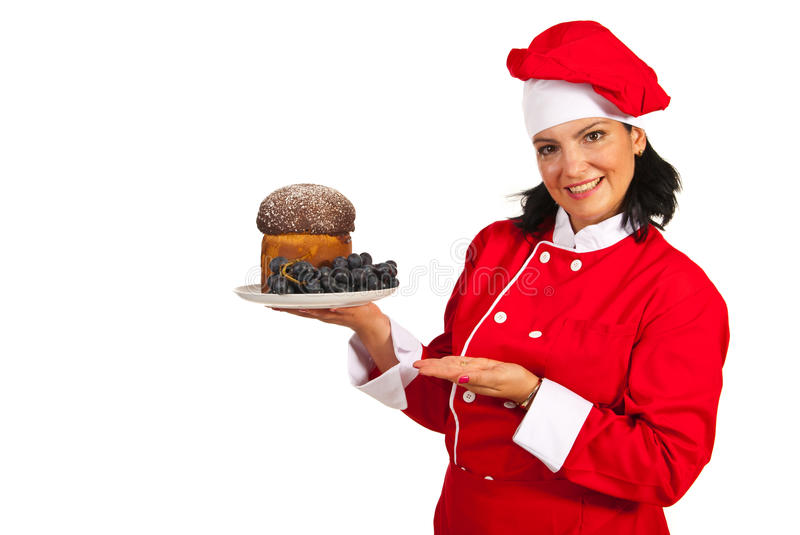 Woman chef showing cake royalty free stock images