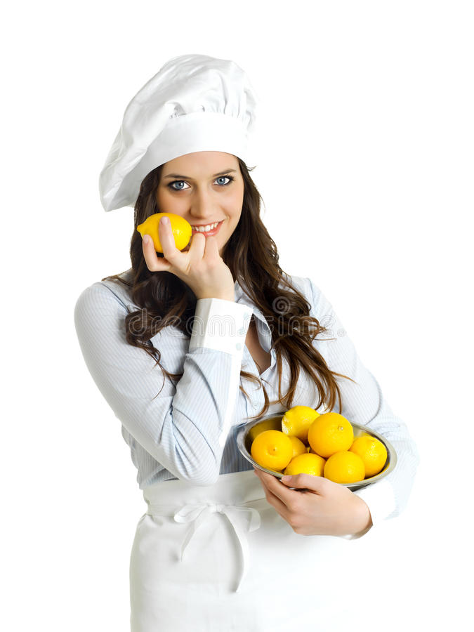Chef with yellow lemons. Woman chef with yellow lemons stock photo