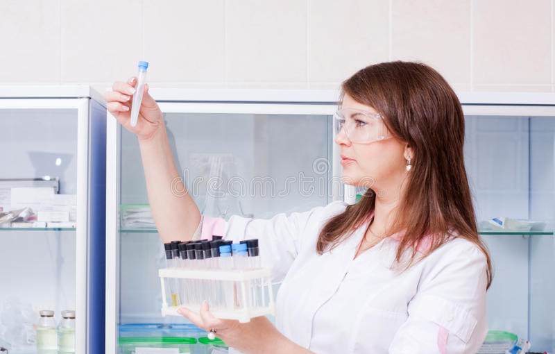 Woman with chemical glassware