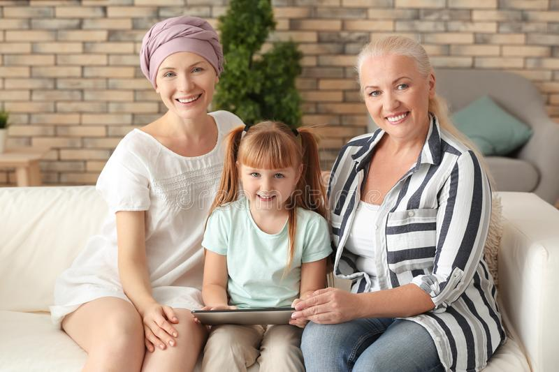 Woman after chemotherapy with her family at home stock photos