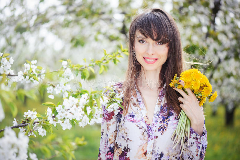 Woman in a cherry garden stock photography