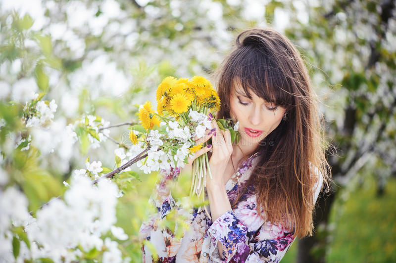 Woman in a cherry garden stock image