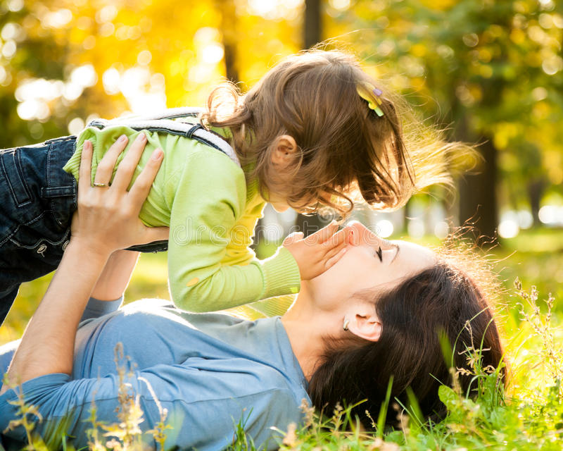 Woman with child in autumn stock images