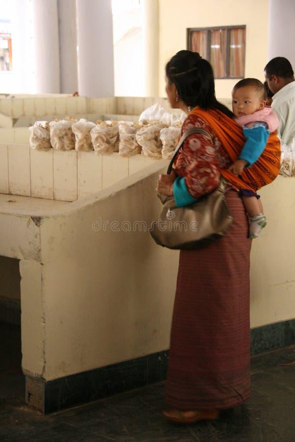 Woman and child - Centenary Farmers Market - Thimphu - Bhutan royalty free stock photos