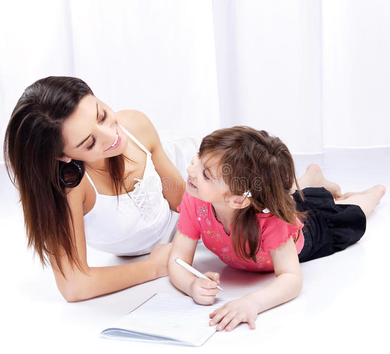 Download Woman And Child Drawing On Notepad Stock Image - Image of happiness, white: 22485937