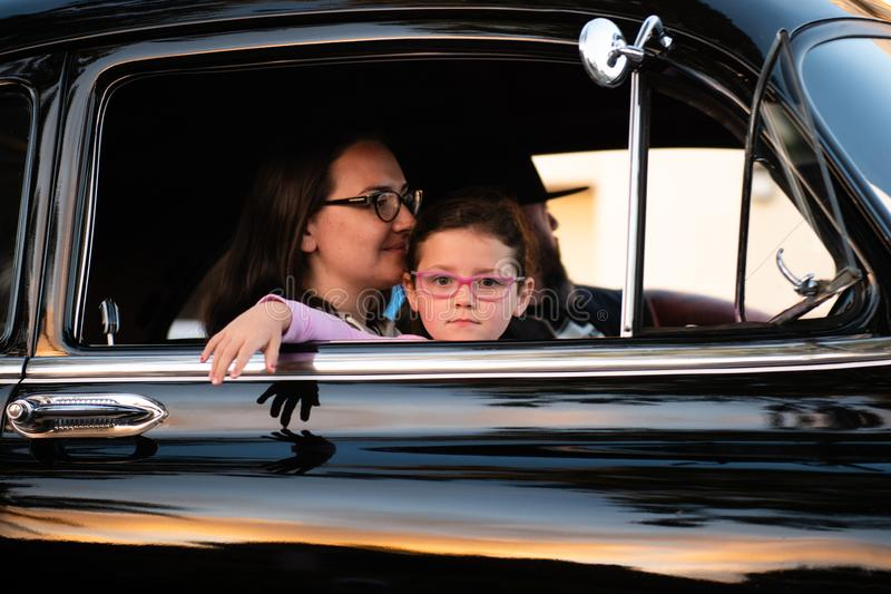 Woman and Child Inside Car stock photos