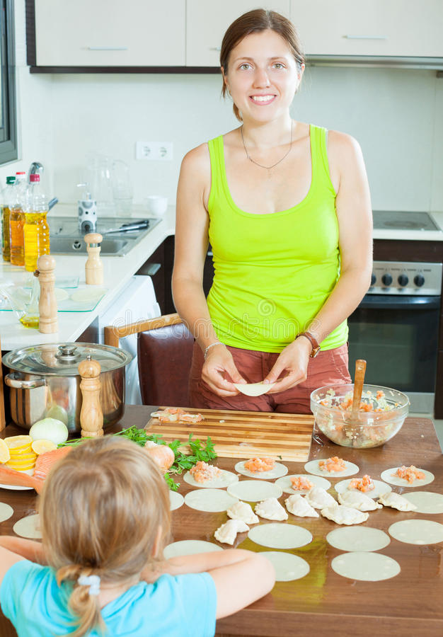 Download Woman With A Child Making Fish Dumplings Freshest Salmon Stuffi Stock Image - Image: 33094025