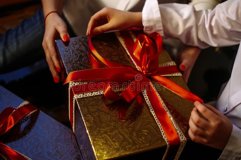 Woman and child open a gift stock images
