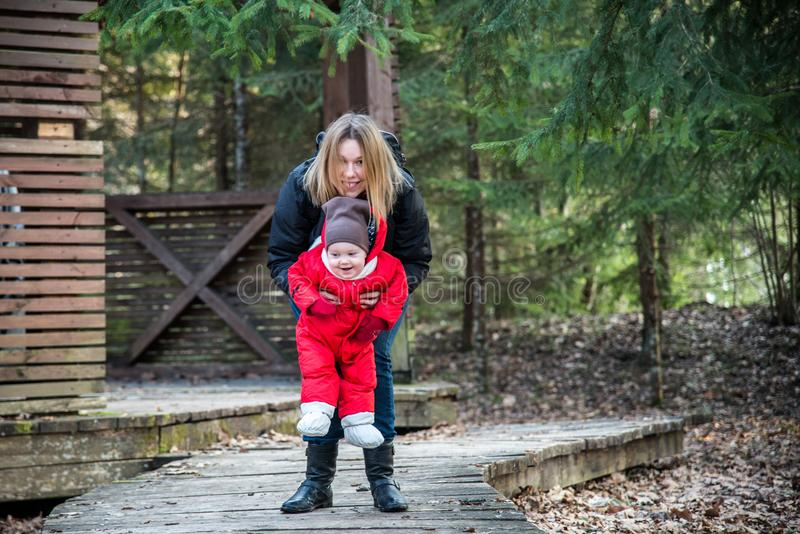 Woman with child in park stock image