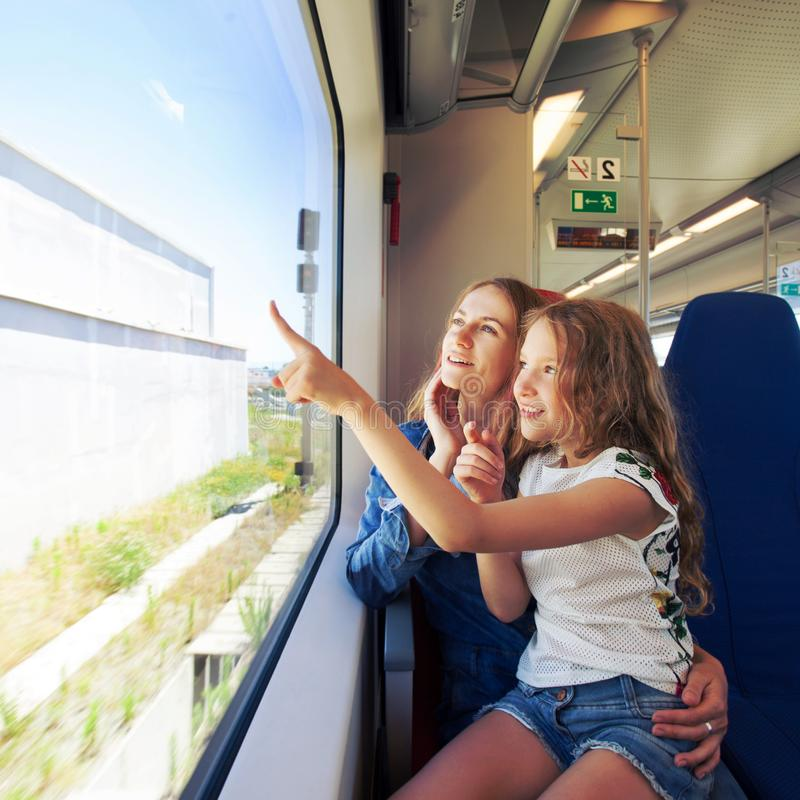 Woman with child traveling by pablic transport royalty free stock photography