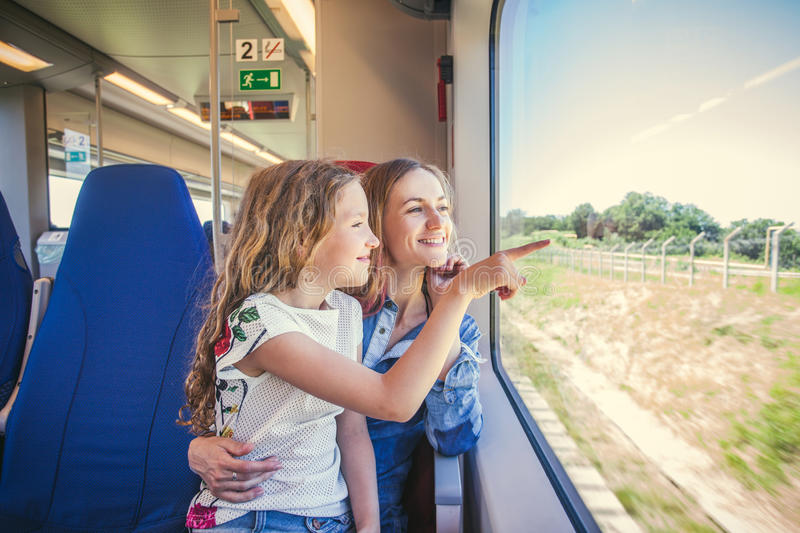 Woman with child traveling by public transport royalty free stock images