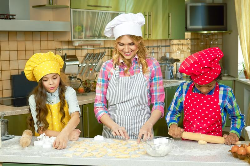 Woman and children make pastry. royalty free stock photo