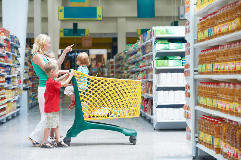 Woman and children making shopping stock images