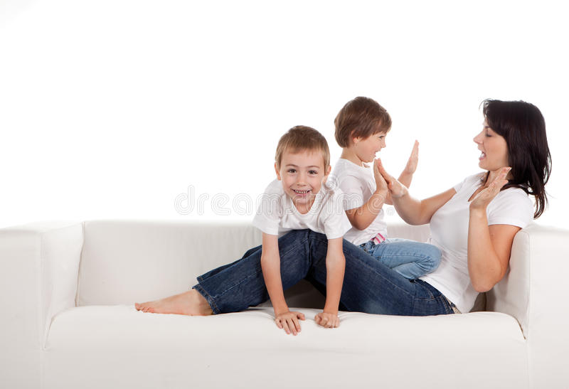 Woman and children playing stock photography