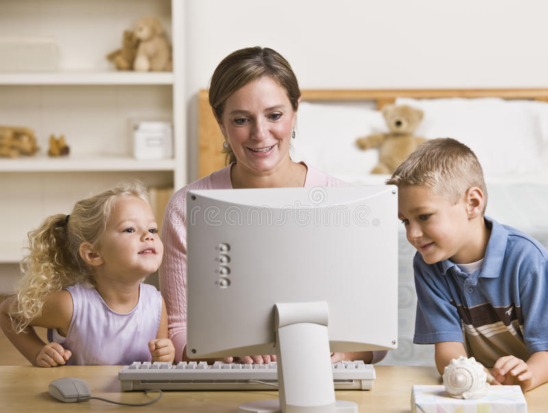 Download Woman And Children Playing On Computer Stock Image - Image: 10196485