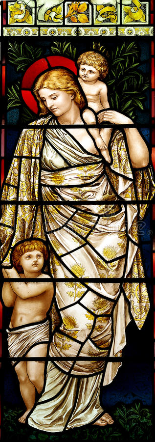 Woman with children in stained glass. A photo of a woman with children in stained glass royalty free stock images