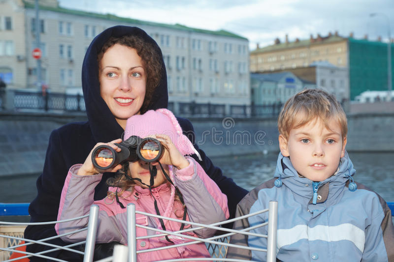 Woman With Children Stand On Background Of Water Stock Images