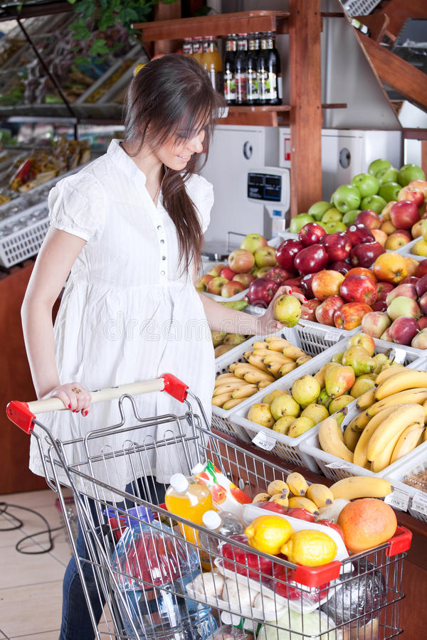 Woman choose food in supermarket royalty free stock image
