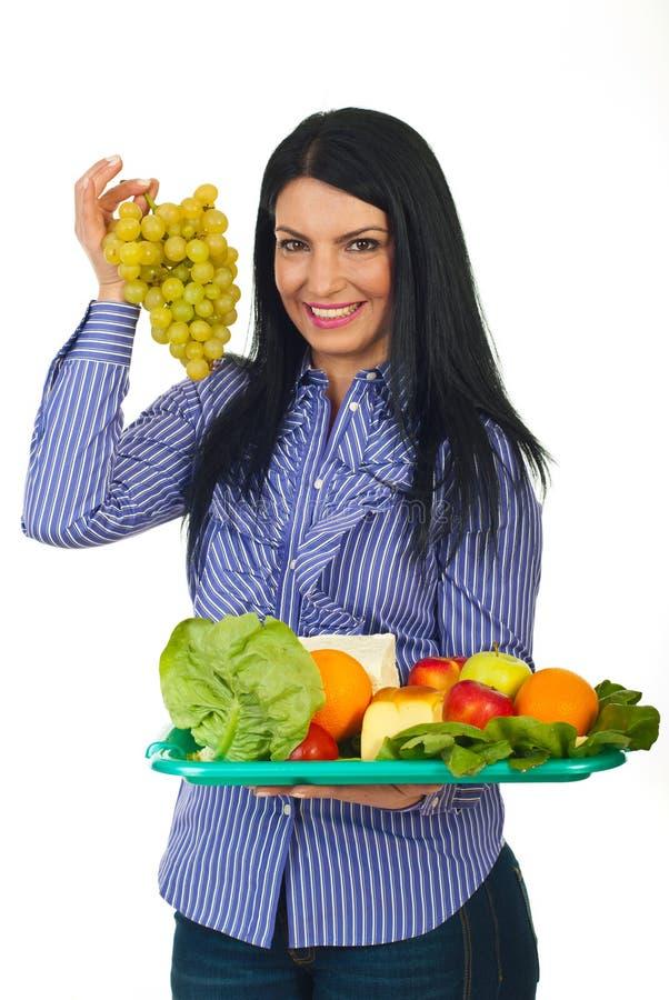Woman choose green grape