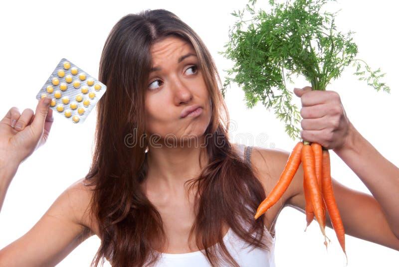 Woman choose between organic fresh carrots royalty free stock image