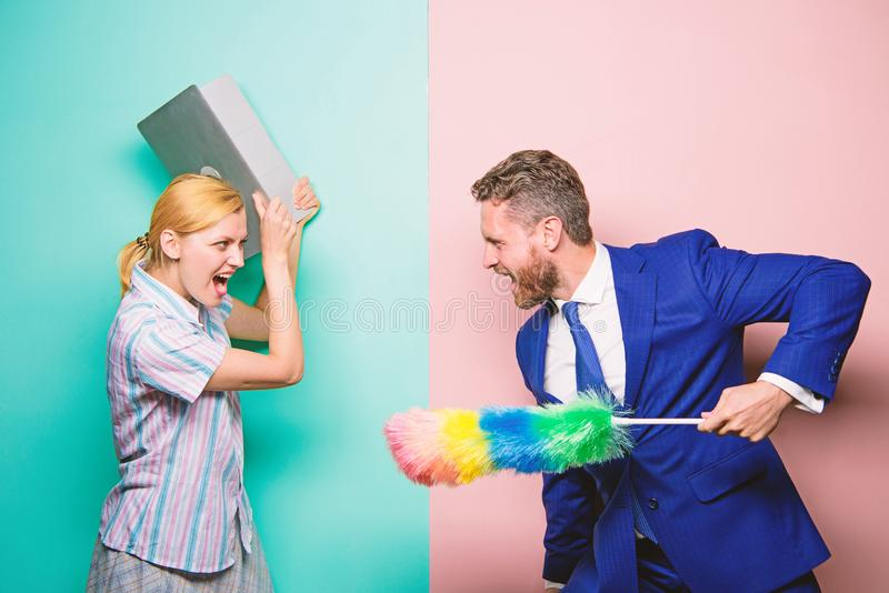 Woman choose to work digital technology. Man force girl to clean up. Gender inequality start from household. Gender royalty free stock image