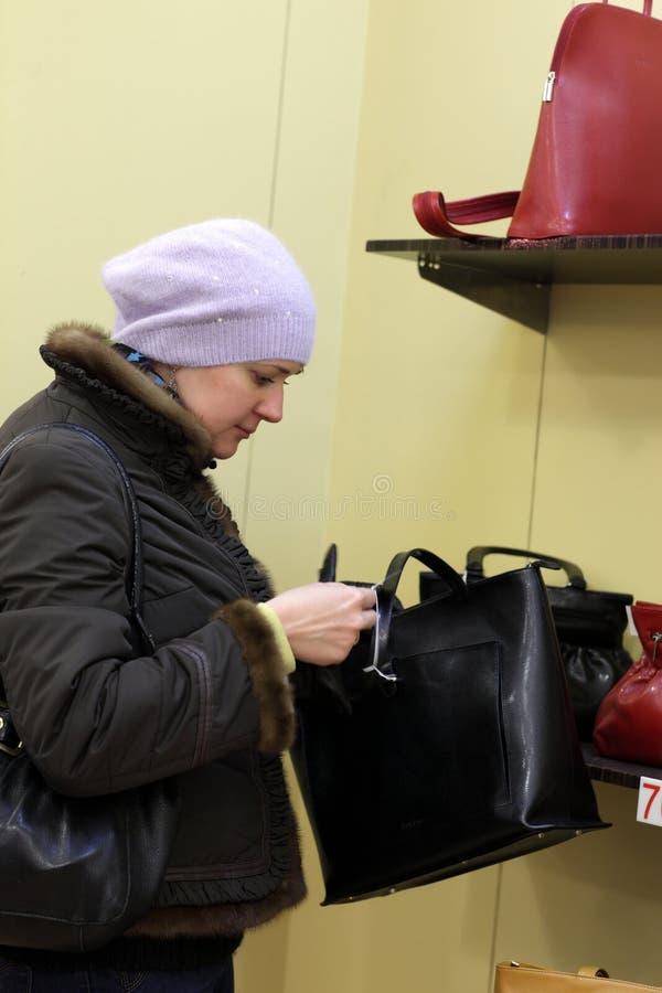 Free Woman Chooses Bag Royalty Free Stock Image - 18788376