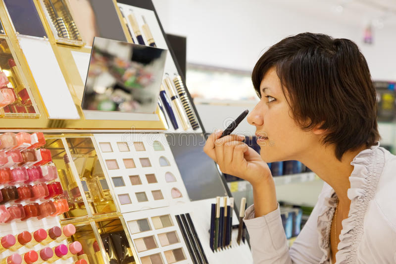 Woman chooses the cosmetic royalty free stock photos