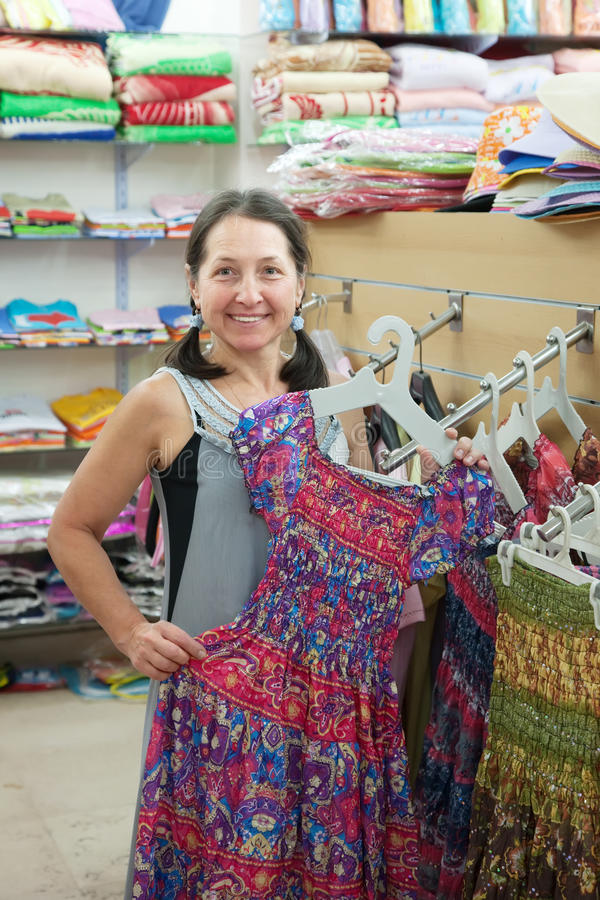 Download Woman  Chooses Dress At  Shop Stock Photo - Image: 24691670