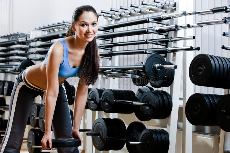 Download Woman chooses dumbbells stock photo. Image of countless - 28494274