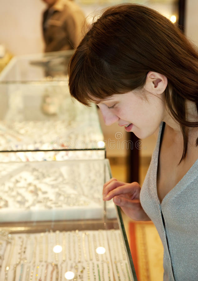 Download Woman  chooses jewelry stock image. Image of girl, customer - 23334481