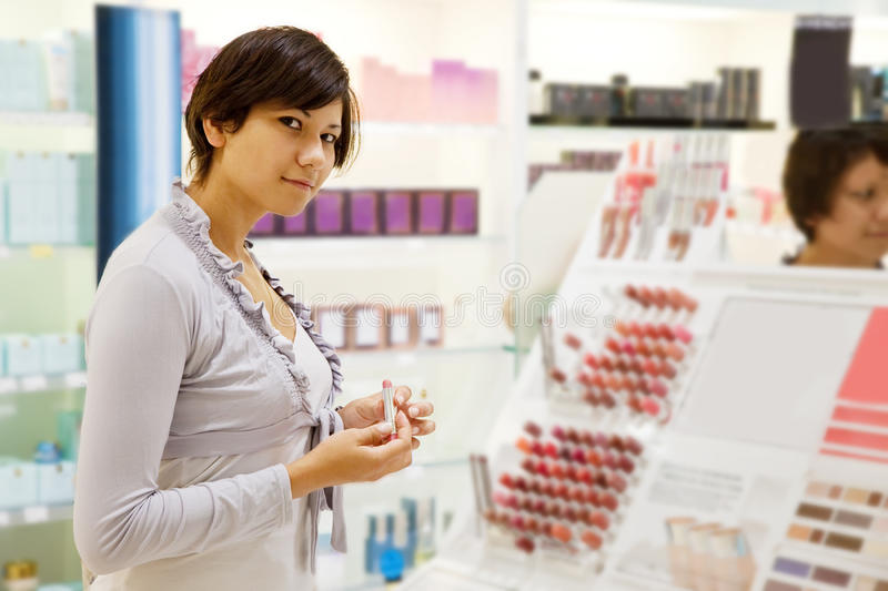 Woman chooses the lipstick royalty free stock photography