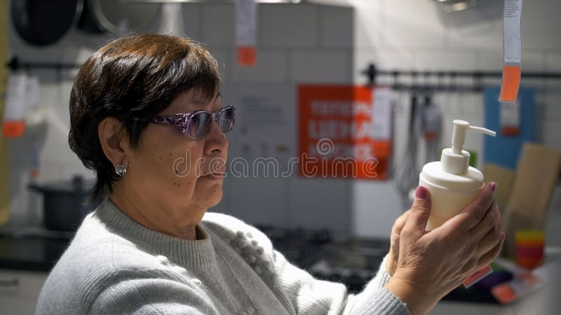 Woman chooses in shop soap. stock photography