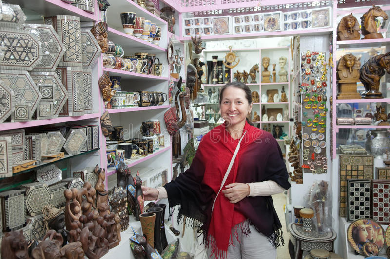 Download Woman  Chooses Souvenirs In Egyptian Shop Stock Image - Image: 23522299